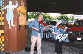 [photo, Street musicians near Baltimore Farmers' Market, Holliday St., Baltimore, Maryland]